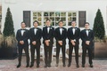 groom and groomsmen in tuxedos at admiral's house in seattle classic wedding attire