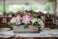 pink peonies, purple blossoms, lace table runner, greenery, wooden planter