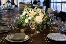 Wood table gold candle votives, small low centerpiece eucalyptus leaves, scabiosa pods, white flower