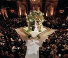 Jewish wedding with chuppah in center