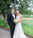 Bride in lace Legends Romona Keveza wedding dress with groom in tuxedo bow tie ivory blush bouquet