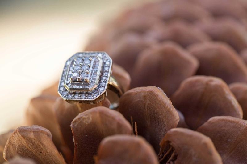 vintage cluster engagement ring round baguette diamonds princess cut on pinecone