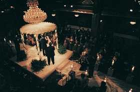 Ceremony in the round with chandelier