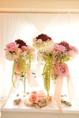 Summer wedding pink centerpiece with sea shells