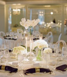 wedding reception white flower centerpiece rose hydrangea orchid napkin gold ring hotel casa del mar