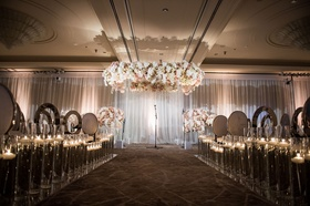 Ballroom jewish wedding ceremony at country club white drapery silver chrome chairs no aisle runner