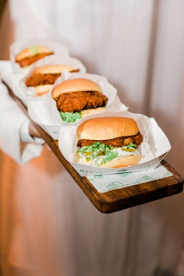 wedding after party snack shake shack chicken sandwich lettuce pickles wood serving tray