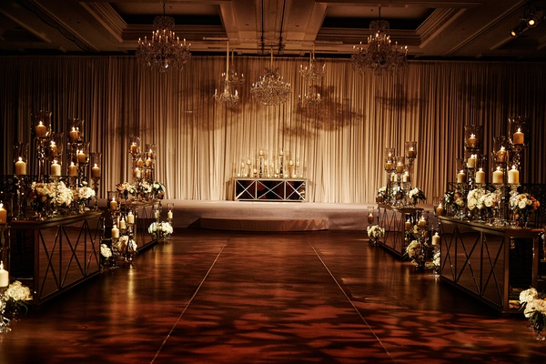 opulent chicago wedding ceremony decor with drapery chandeliers white flowers mirror details