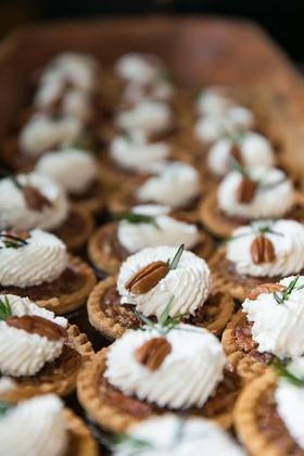 wedding desserts miniature pecan pie with pecan on top whipped cream
