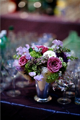 Wedding reception floral arrangement of white, pink, light purple, and green flowers