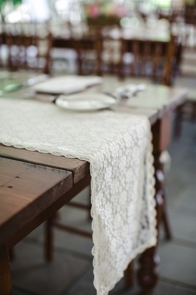 Scallop hem lace runner at rustic wedding wood reception table