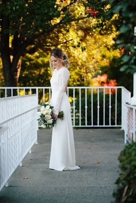 bride in sarah seven wedding dress, sheath wedding dress with crepe skirt and lace long sleeves