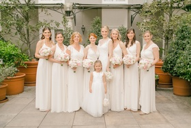 Bride with bridesmaids in white mismatched bridesmaid dresses in different necklines