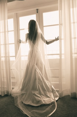 Sepia toned photo of Vera Wang bridal gown