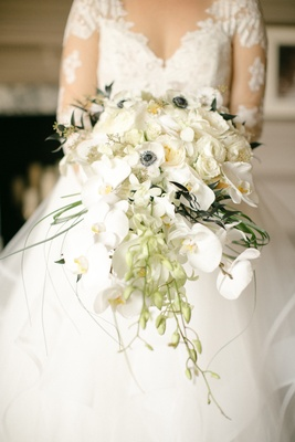 bridal bouquet with Phalaenopsis orchids, garden roses, and anemones