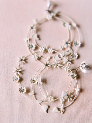 multi-hoop earrings with little white flowers for wedding