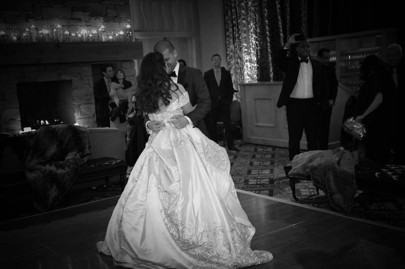 Bride and groom dancing at indoor reception