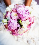 Bride holding blush and cream flowers