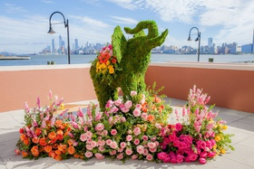 indian wedding ceremony moss sculpture of elephant pink orange yellow roses flowers new york city