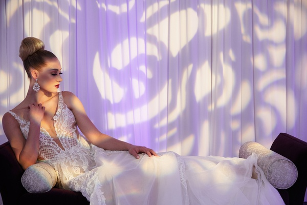 bride reclining wedding gown pallas couture australian bridal designer deep v overskirt beading