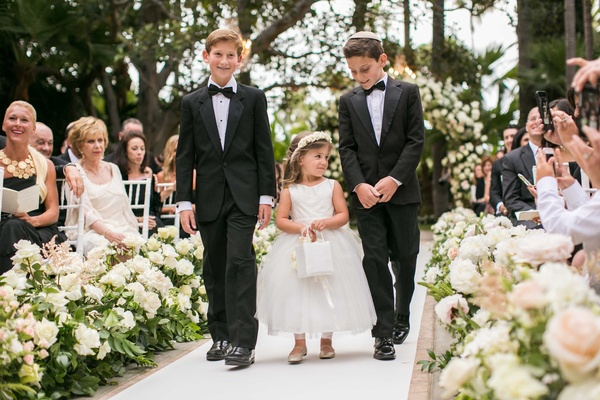 Groomsmen In Bow Tie And Yarmulke With Flower Girl Basket White Crown Bride Monique Lhuillier Wedding Dress Walks Down Aisle