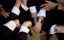Groomsmen's hands showing off men's jewelry cufflinks
