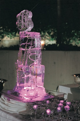 Purple and pink lit ice sculpture and ice cubes