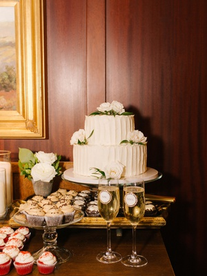 wedding reception dessert table simple two layer cake fresh roses mr mrs champagne glasses cupcakes