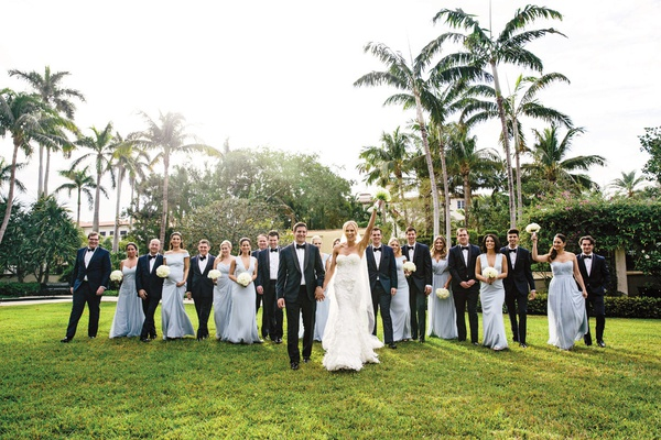 bride in marchesa wedding dress, bridesmaids in light blue gowns from the dessy group