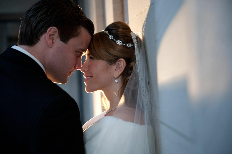 Bride in a stole and veil with groom