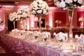 long tablescape blush palette tall centerpieces feminine motif gold ghost chairs fancy linens dallas