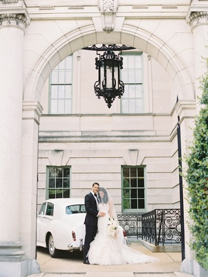 Bride and groom couple wedding portrait in arch at Anderson House in Washington DC mermaid gown