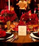 Brown linens topped with gold candlesticks and vases