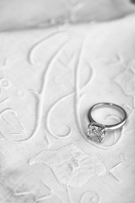 Black and white photo of solitaire diamond engagement ring