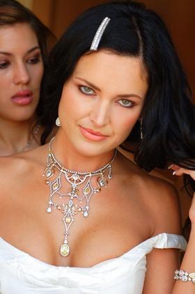 bride wears beautiful diamond and jeweled necklace