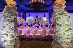Wedding reception inspiration shoot white table linens chair covers flowers white rose hydrangea
