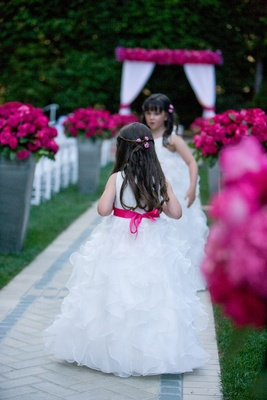 Ball gown on flower girl with hot pink ribbon sash