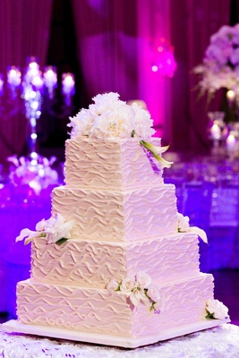 White confection with fresh flowers and ripple design