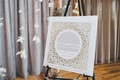 Floating flowers on strings with birch branches ketubah on stand gold details circle sunburst design