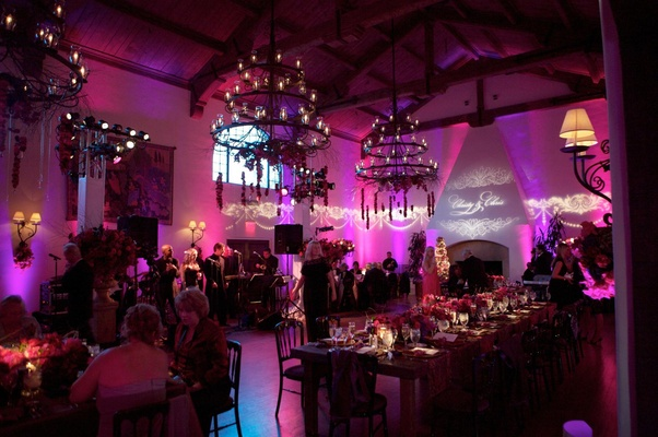 Reception room with chandeliers and vibrant lighting