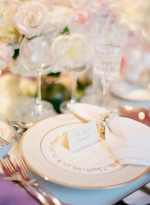 Gold-rimmed charger and wedding menu card