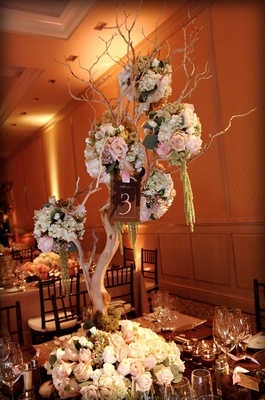Floral-embellished tree branches on table
