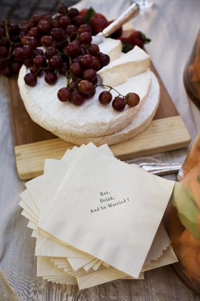 Cute custom napkins and slices of brie
