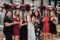 bride and bridesmaids with cocktails at bridal shower