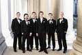 groom groomsmen classic black tuxedos roman catholic church ceremony religious wedding smiling