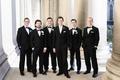 groom groomsmen classic black tuxedos roman catholic church ceremony religious wedding smiling