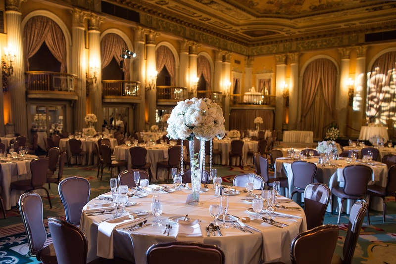A great gatsby wedding at an old hollywood landmark inside weddings wedding reception table with tall centerpiece topped with white flowers and suspended crystals junglespirit Images
