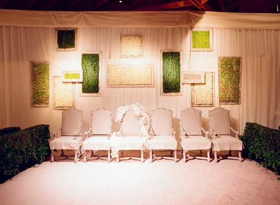 The veiling ceremony chairs and framed greenery