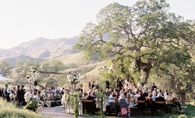 Alfresco wedding under oak tree in California