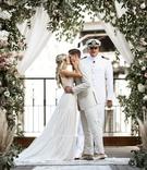 wedding ceremony vintage rug aisle runner greenery pink lavender flowers boat captain officiant